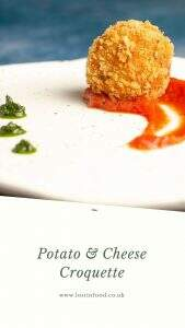 A crumbed potato and cheese croquette served with a swirl of rich tomato sauce.
